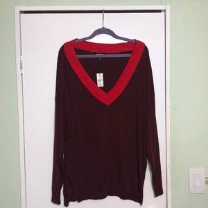 Medium Express oversize deep V neck sweater.